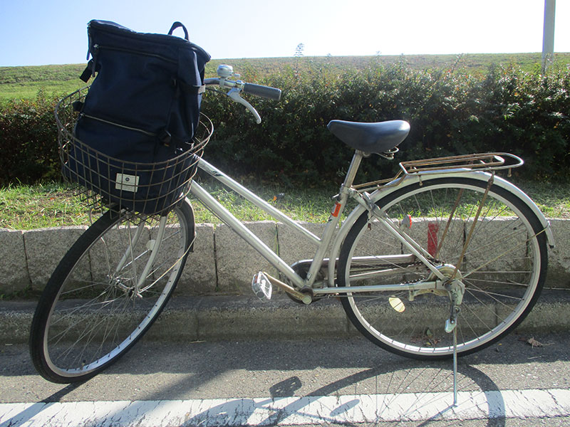 "Photo 2: My bicycle and my backpack which includes my ""secret"" tools (ballpoint pen, memo pad, smartphone, towel, and tea). With these tools I can respond to most of the consultations."